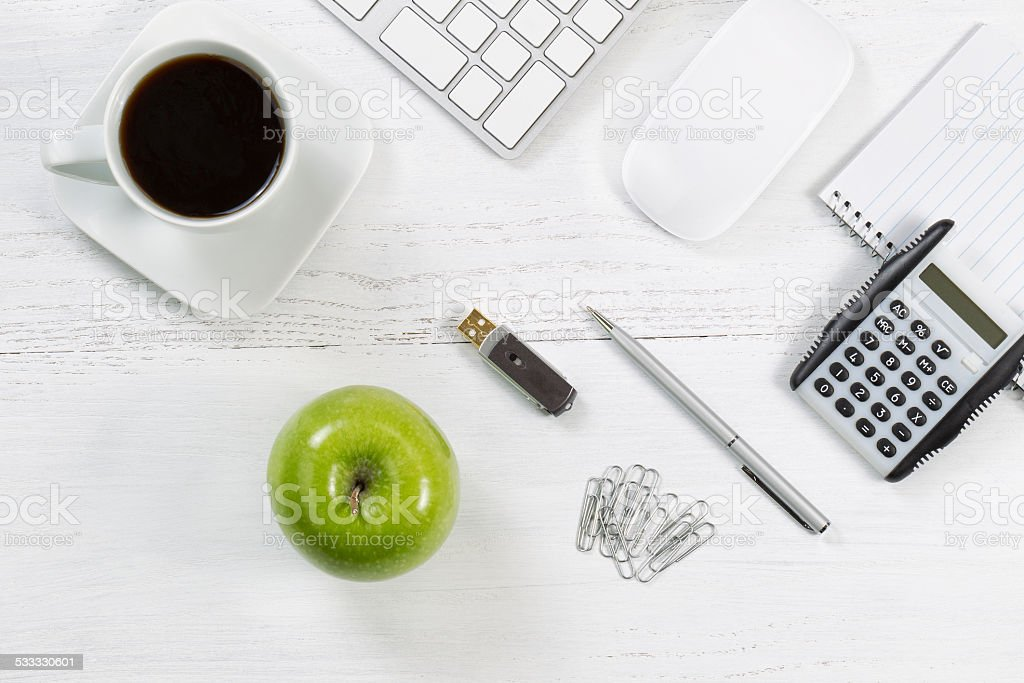 Desktop with business objects and snack foods stock photo