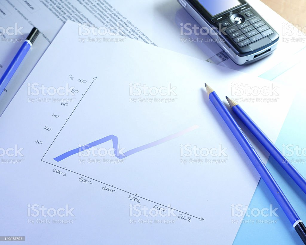 A desktop with office supplies and a mobile phone stock photo