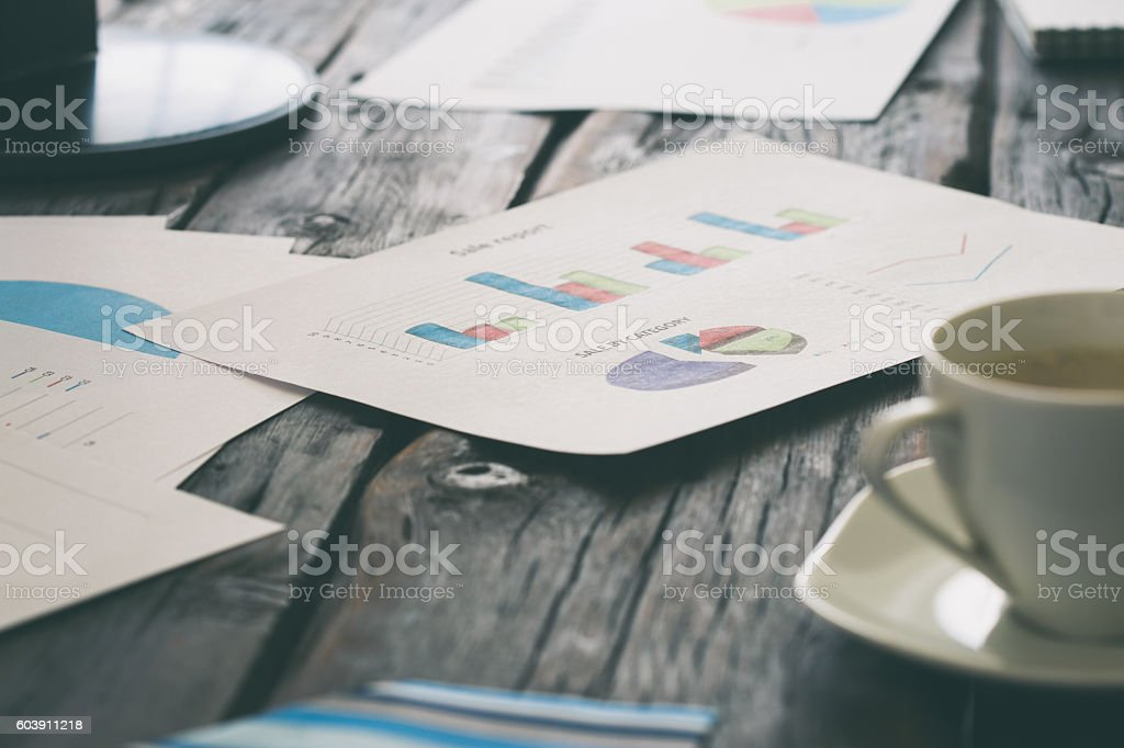 Desktop with quarterly reports and graphs of sales stock photo