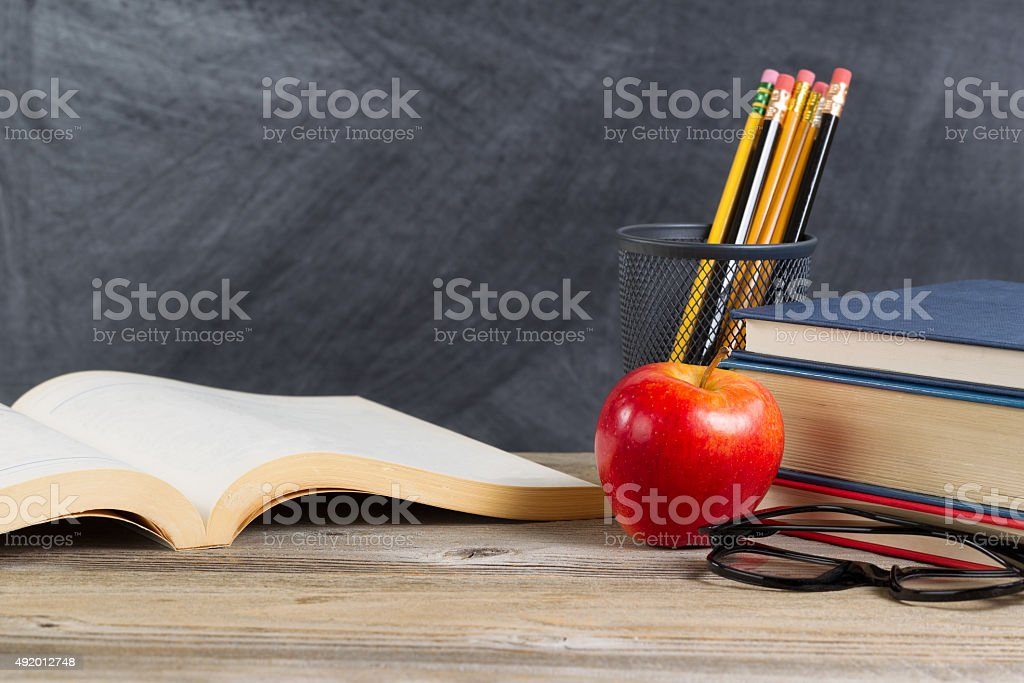 Desktop with reading materials and blackboard stock photo