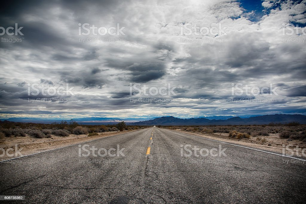 Desolate Desert Road Through San Bernadino County stock photo