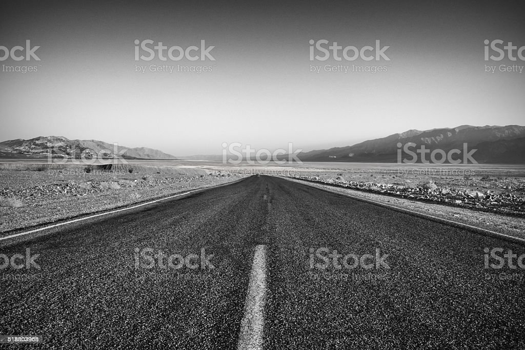Desolate Road Through Death Valley in Black and White stock photo
