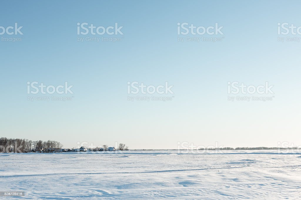 desolate winter landscape near the village stock photo