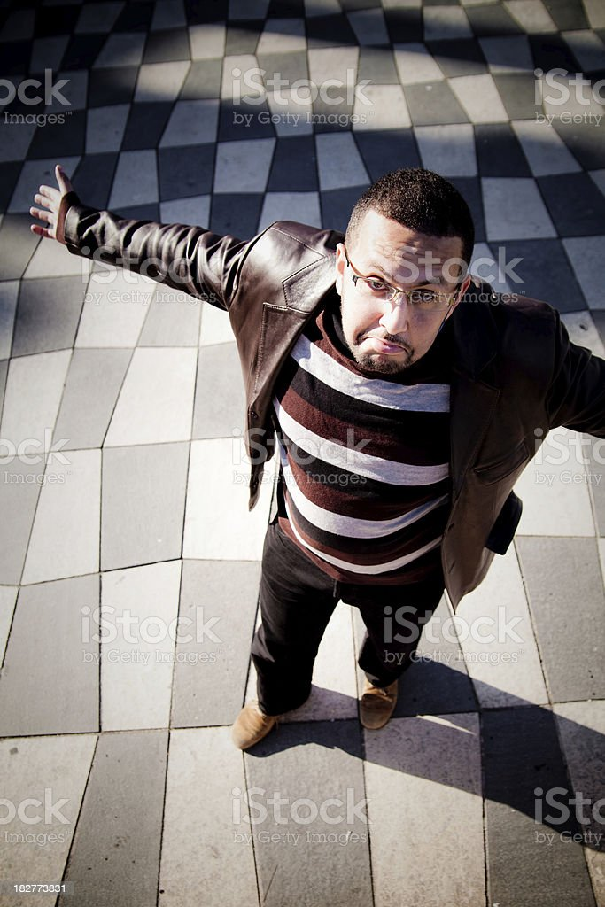 Despair gesture on chequered pattern stock photo
