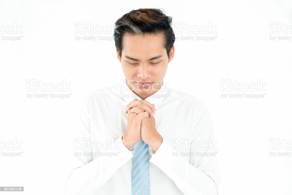 Despaired Asian man asking God about success stock photo