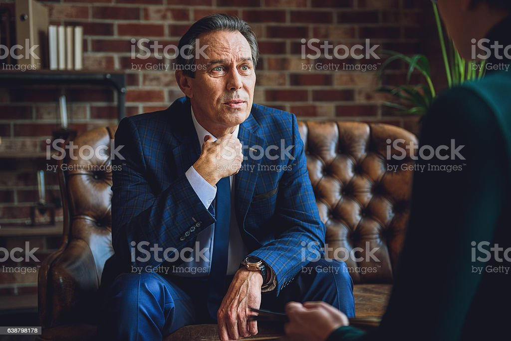 Despaired man sharing his feelings stock photo