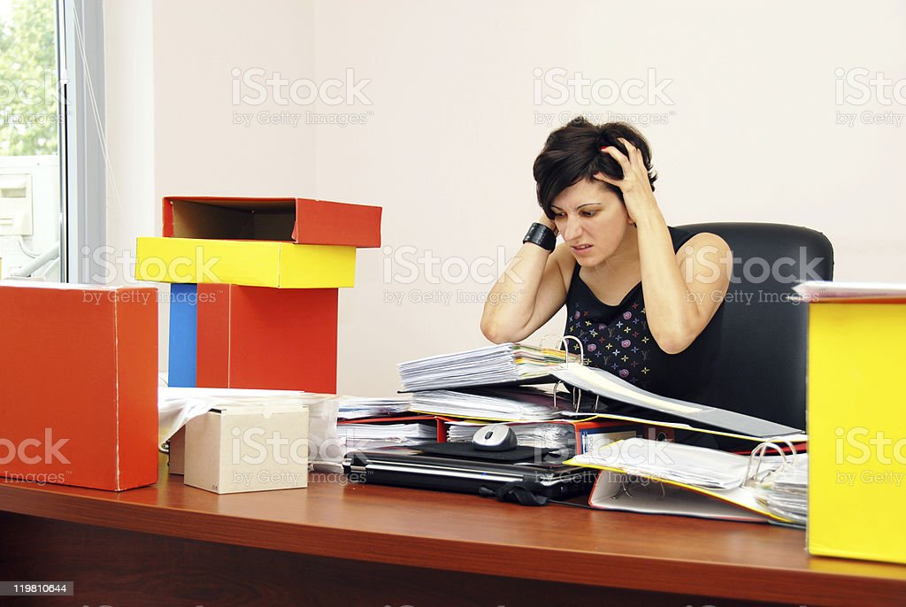 Despaired woman overloaded with work royalty-free stock photo