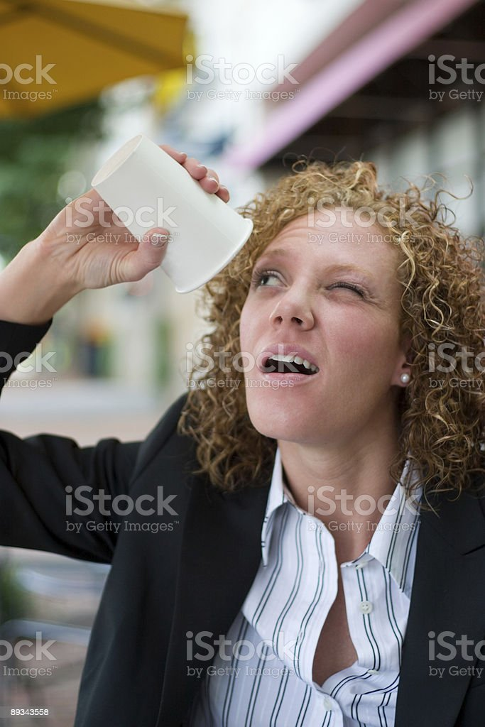 Desperate Business Woman Drinking Coffee royalty-free stock photo