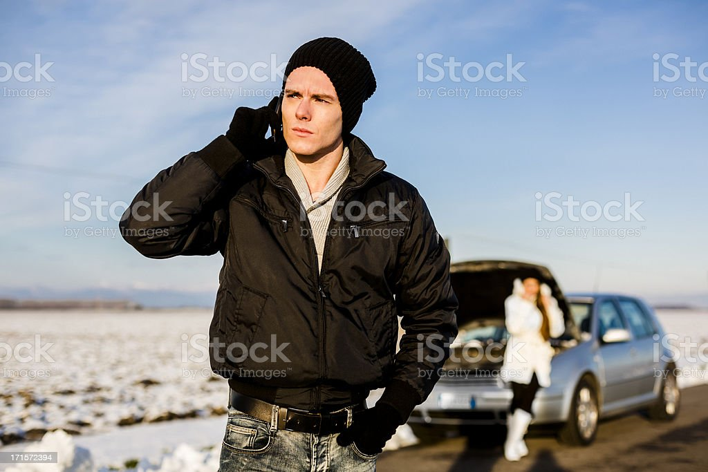 Desperate couple with Car Problem during a cold winter day royalty-free stock photo