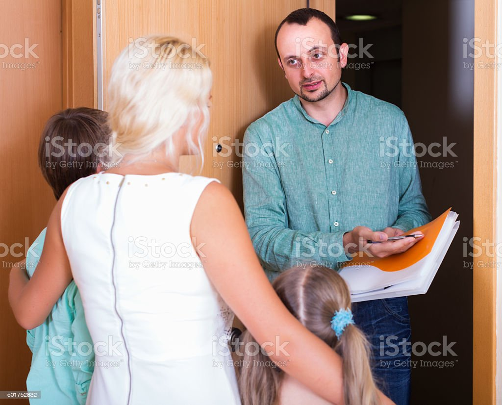Desperate family and irritated inspector stock photo