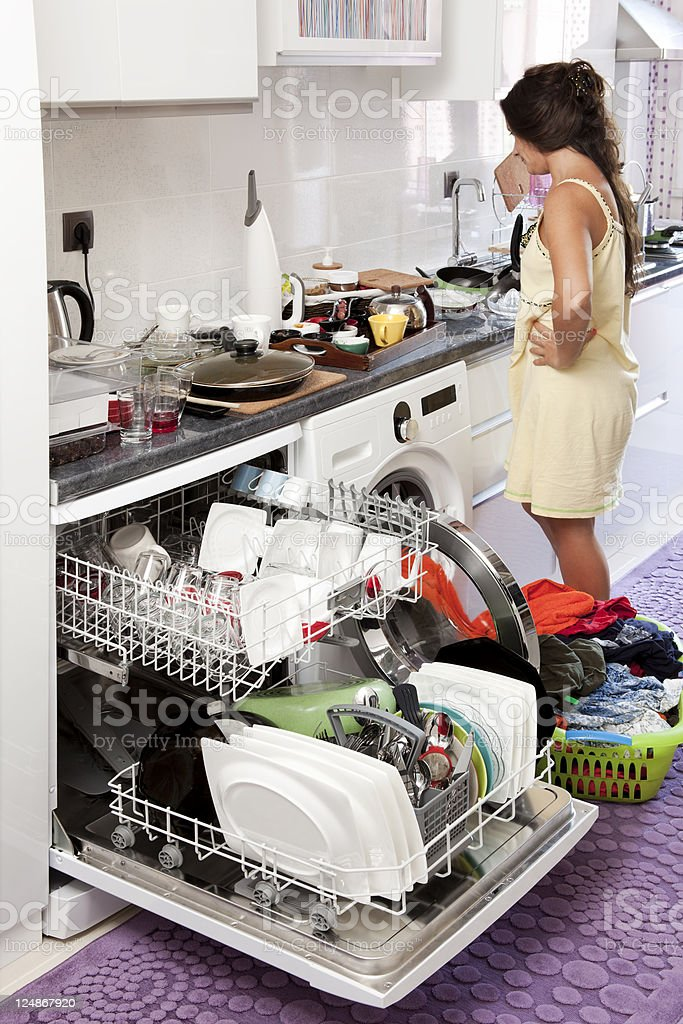 desperate housewife in messy kitchen royalty-free stock photo