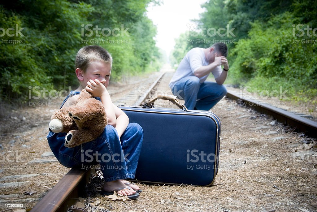 Desperate man and child on train tracks royalty-free stock photo