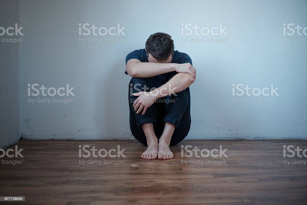 Desperate man in trouble feeling depressed stock photo
