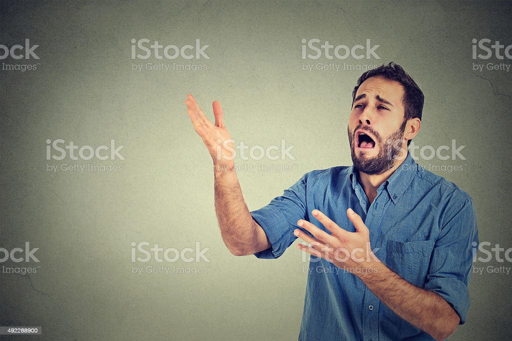 Desperate man screaming asking for help forgiveness stock photo