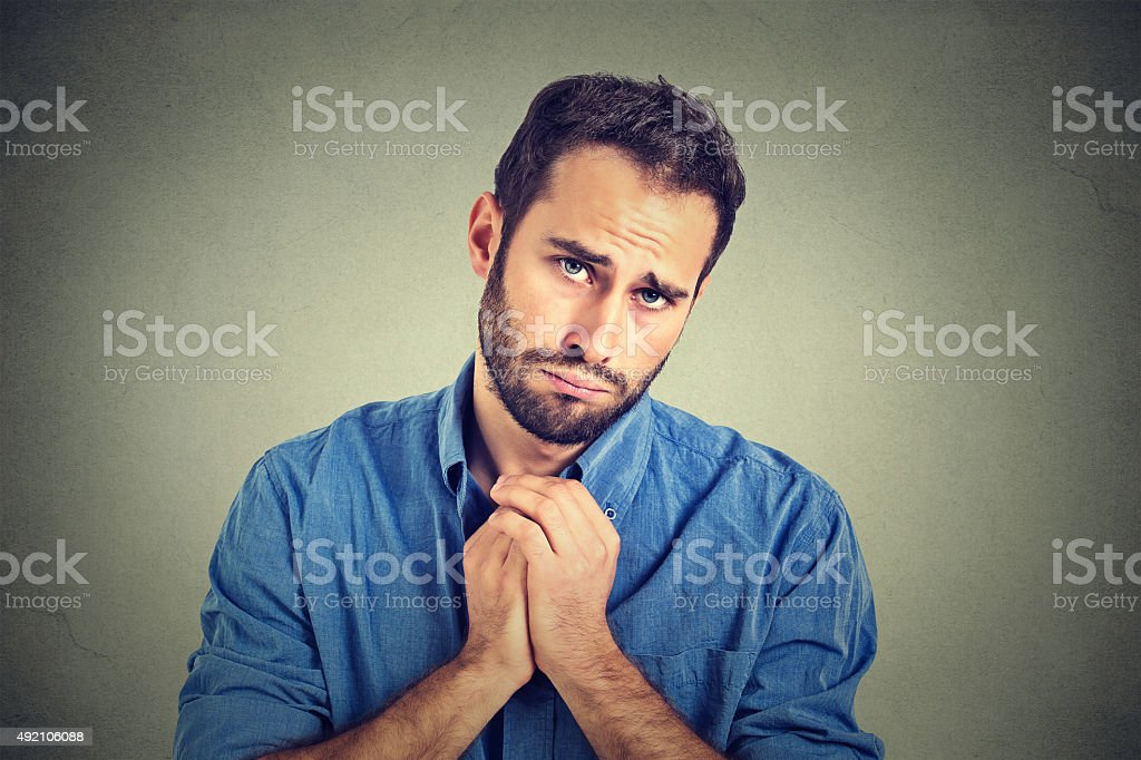 desperate man showing clasped hands asking help forgiveness stock photo