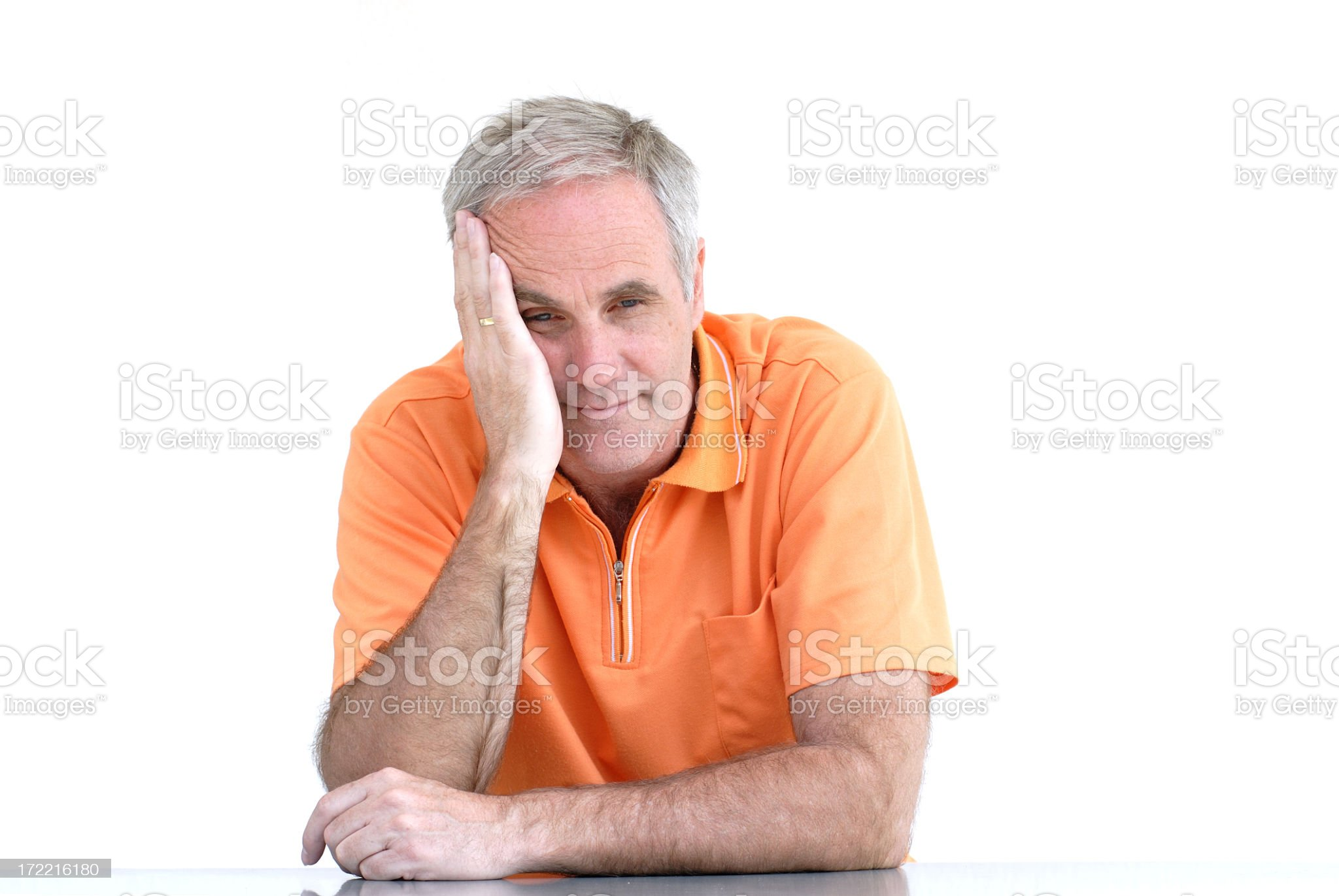 Desperate man with head on his hand looking at camera royalty-free stock photo