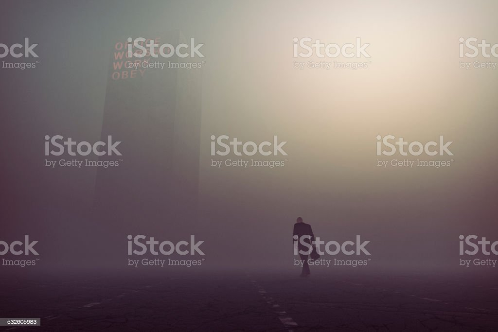 Desperate, tired businessman walking towards office building stock photo