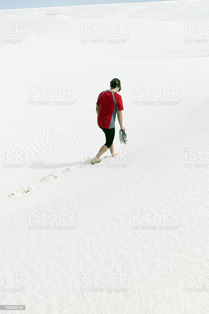 Desperated Woman Walking on White Sand Ripples, New Mexico, USA stock photo