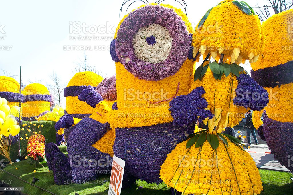 Despicable character with flowers at flower parade stock photo