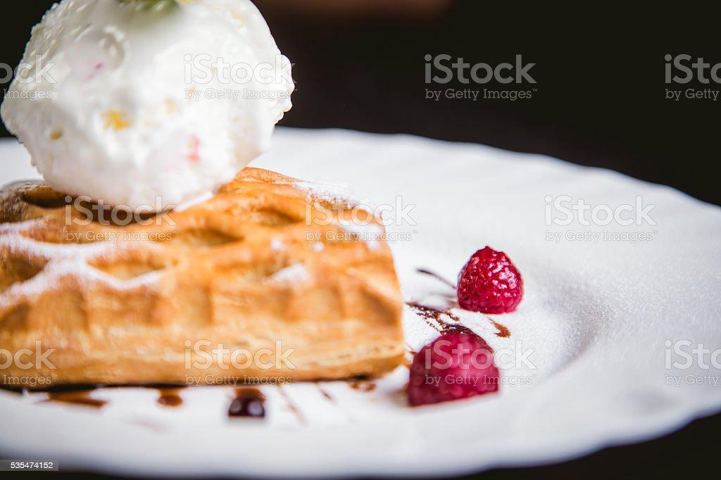 dessert cake with ice cream and raspberries stock photo