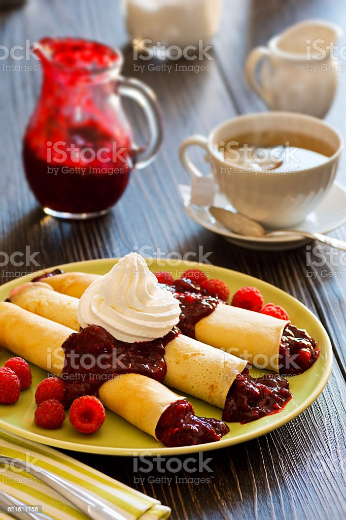Dessert Crepes with Berry Sauce, Raspberries, and Whipped Cream stock photo