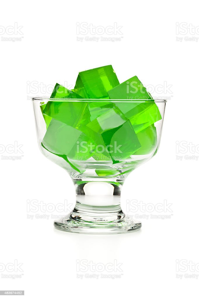 Dessert cup filled with green gelatin cubes. stock photo