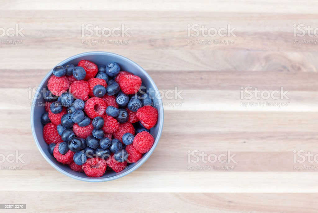 Dessert fresh berries in the bowl. stock photo