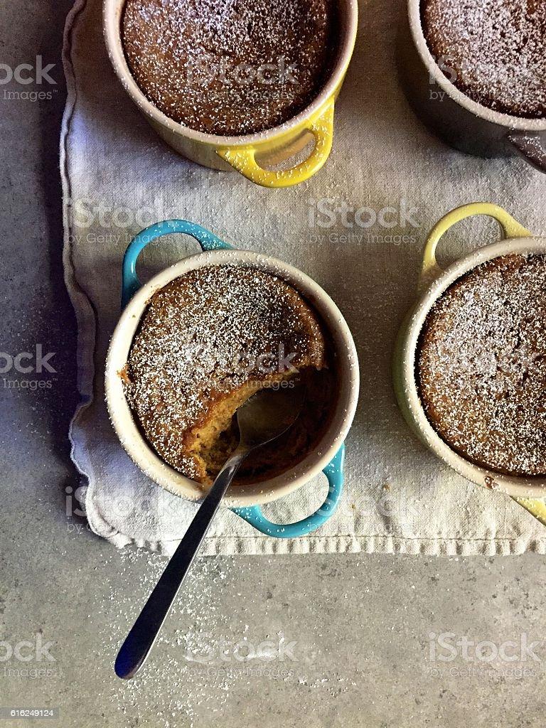 Dessert: Homemade baked gluten-free pumpkin custards in colourful ramekins stock photo