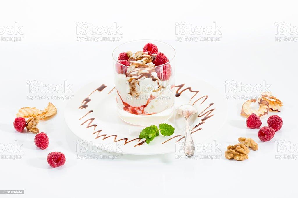 Dessert in glass, curd, yoghurt, dried apple, raspberries, stock photo