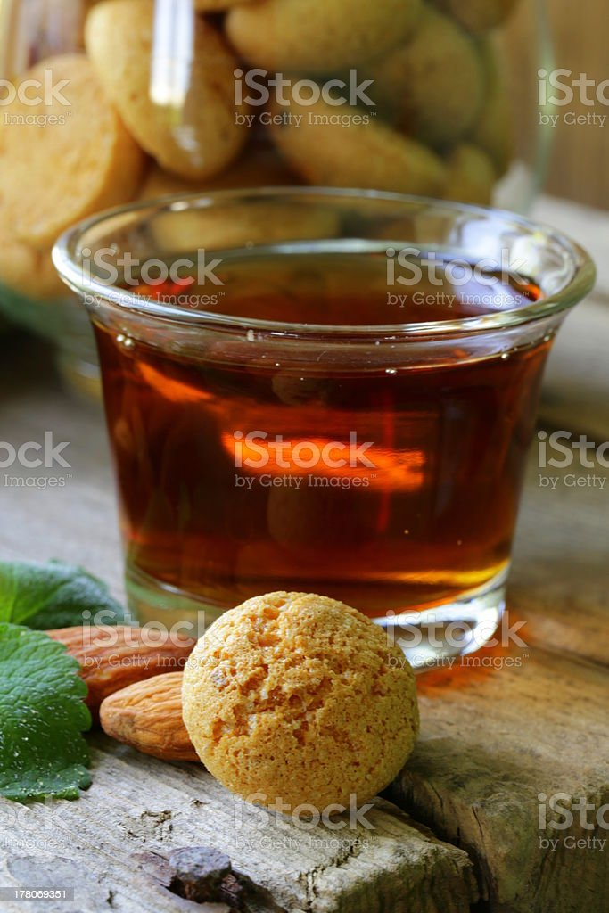 Dessert liqueur Amaretto with almond biscuits (amarittini) royalty-free stock photo