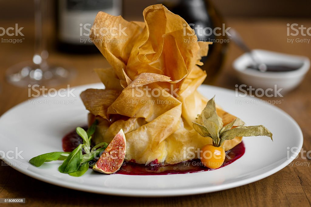 dessert made of phyllo dough in the form of a pouch stock photo