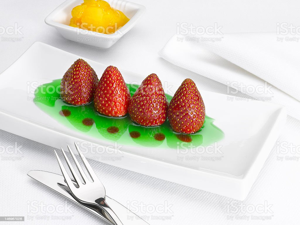 Dessert of strawberries with mint syrup royalty-free stock photo