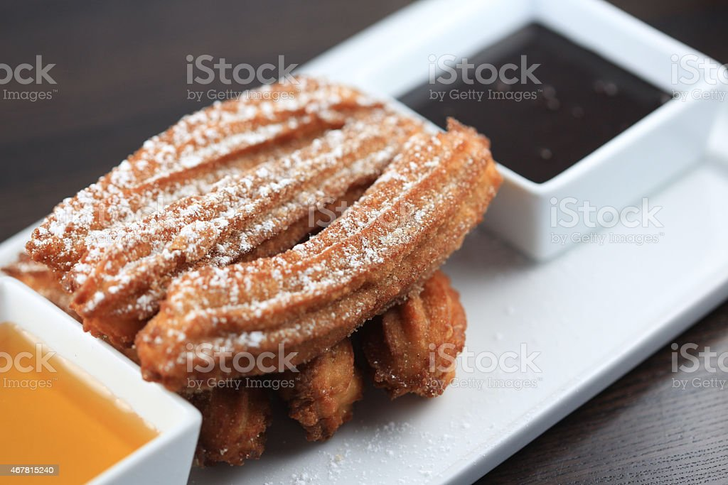 Dessert player with churros and dipping sauce stock photo