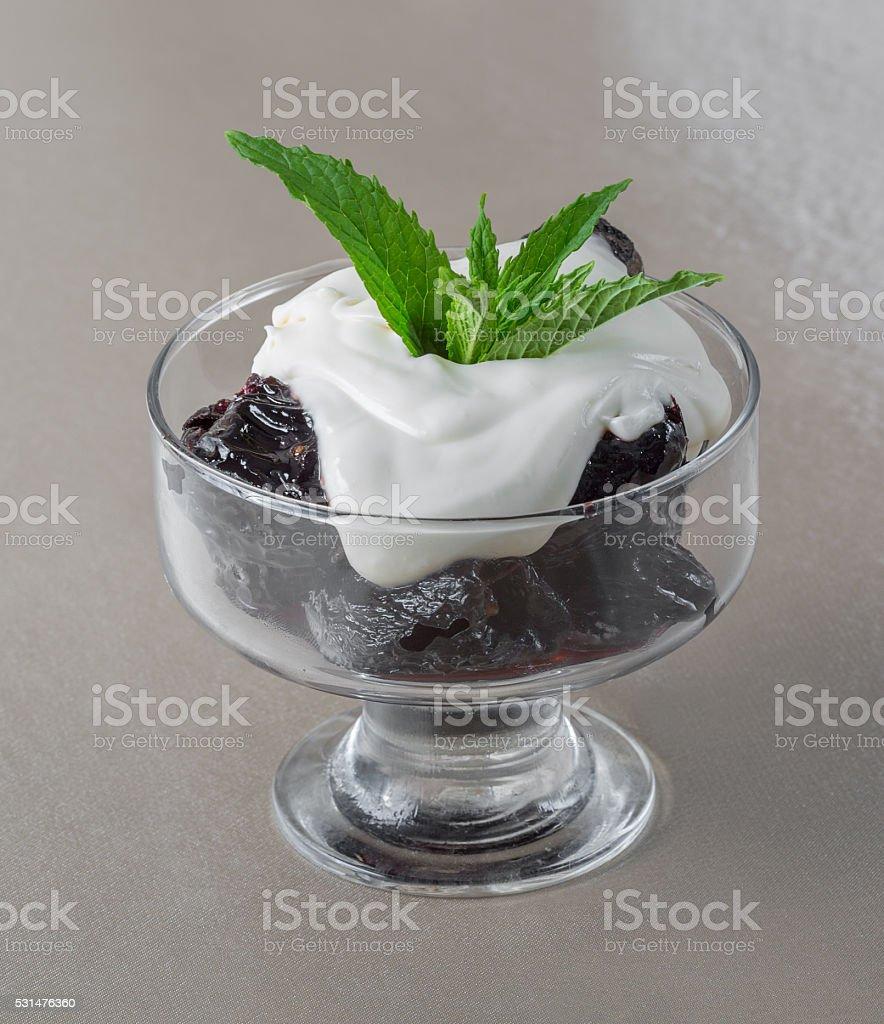 Dessert. Prunes stuffed with Walnut with sweet sour cream stock photo