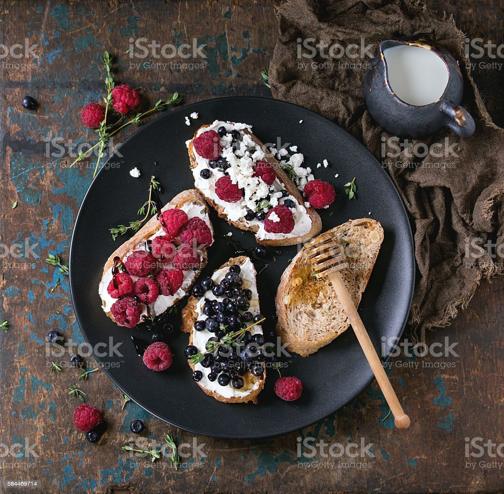 Dessert sandwiches with berries stock photo