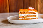 Dessert - sweet cake with orange on a plate