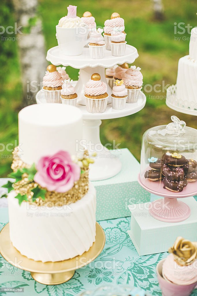 Dessert table with pretty cakes and cookies royalty-free stock photo