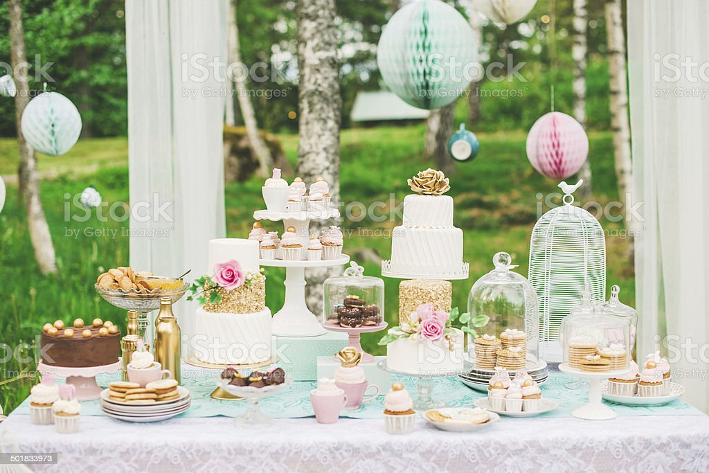 Dessert table with pretty cakes and cookies stock photo