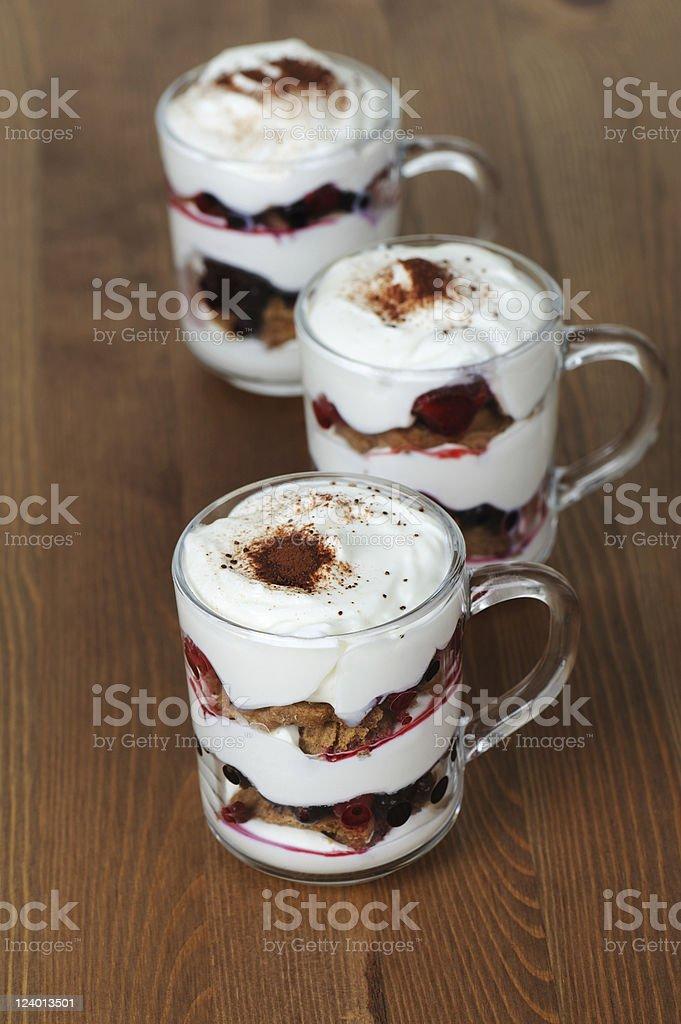 Dessert Tiramisu with Mixed Berries and Almond Biscuit stock photo