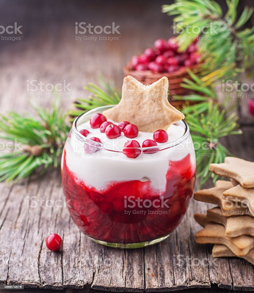 Dessert with cranberry sauce and sour cream decorated gingerbread cookies stock photo