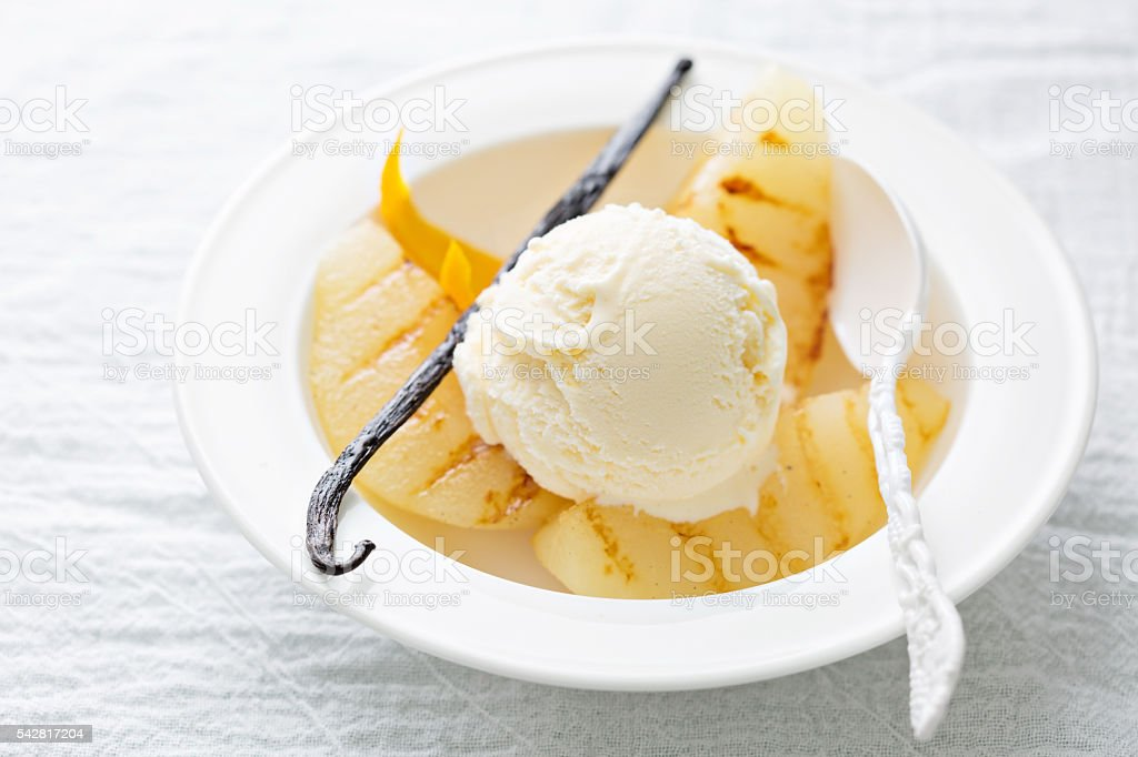 Dessert with ice cream and grilled pears stock photo