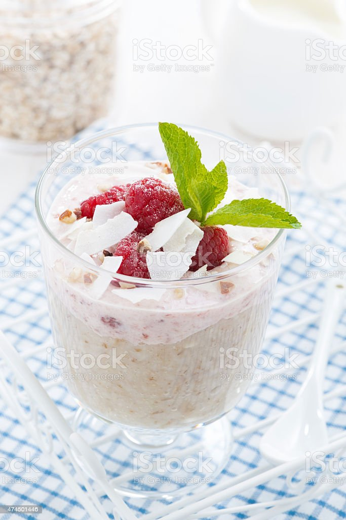 dessert with oatmeal, whipped cream and raspberries, close-up stock photo