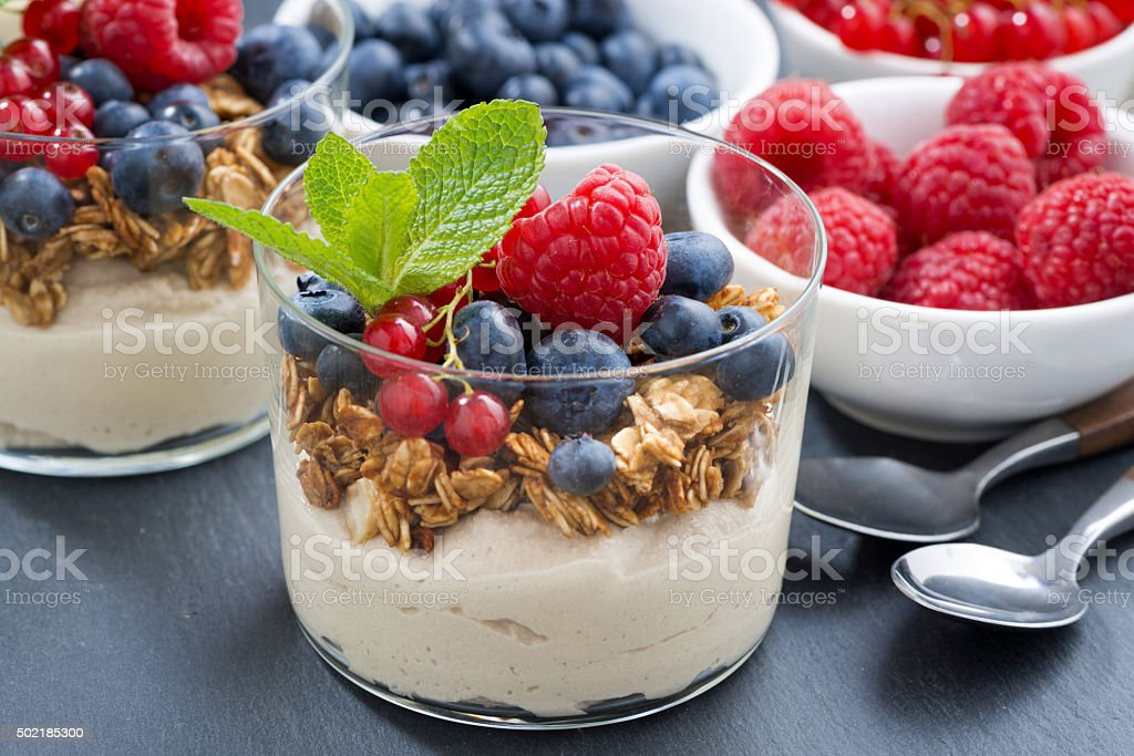 dessert with sweet  milk cream, fresh berries and muesli stock photo