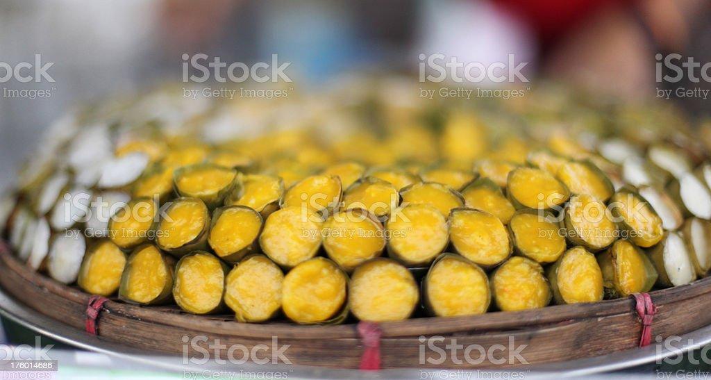 dessert wrapped in banana leaves stock photo