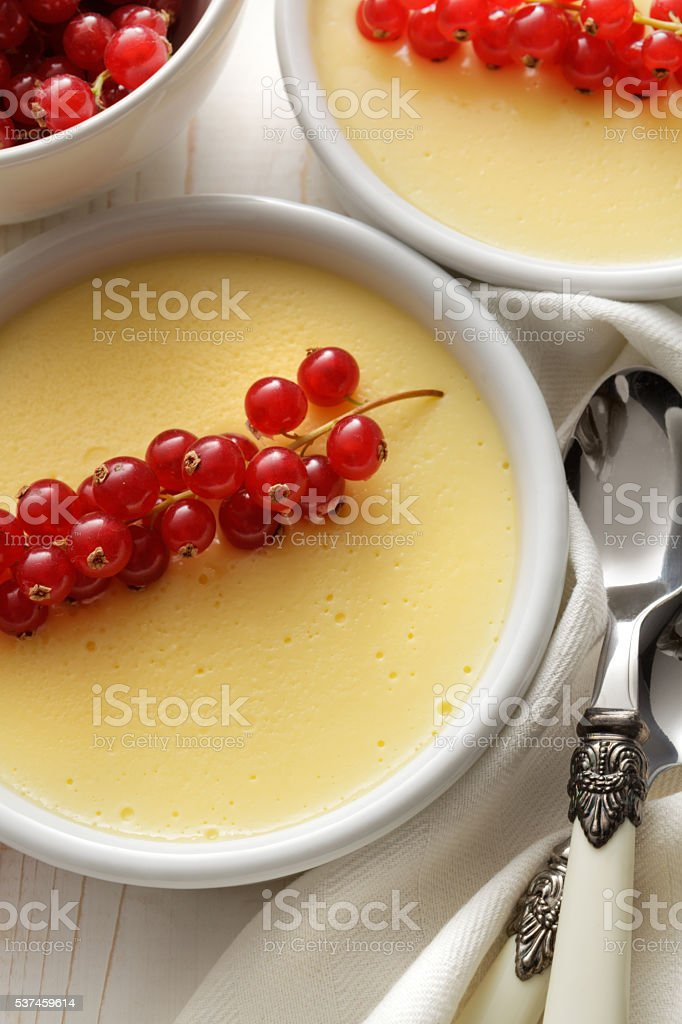 Desserts: Custard Pudding with Red Currant Still Life stock photo