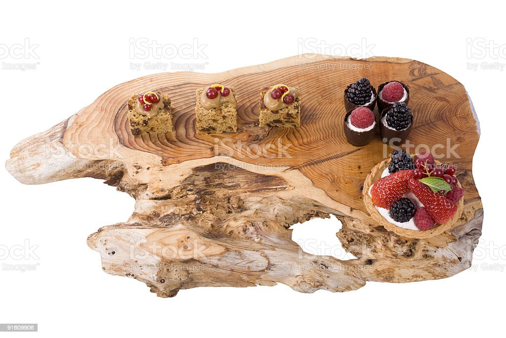 Desserts on Wooden Platter royalty-free stock photo