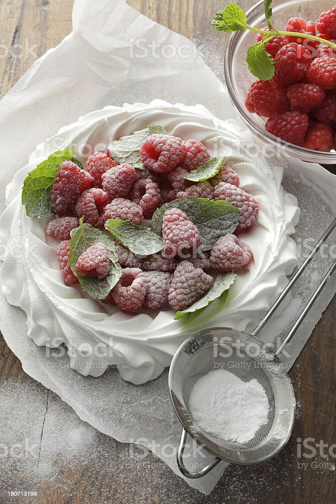 Desserts: Pavlova with Raspberries and Mint Still Life royalty-free stock photo