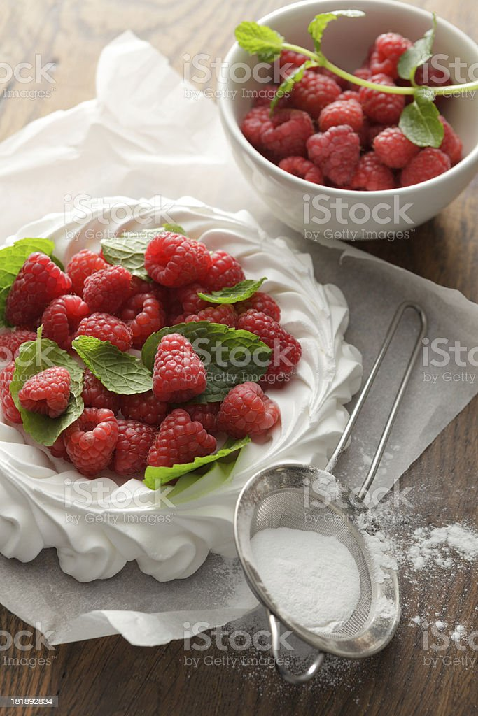 Desserts: Pavlova with Raspberries and Mint Still Life royalty-free stock photo