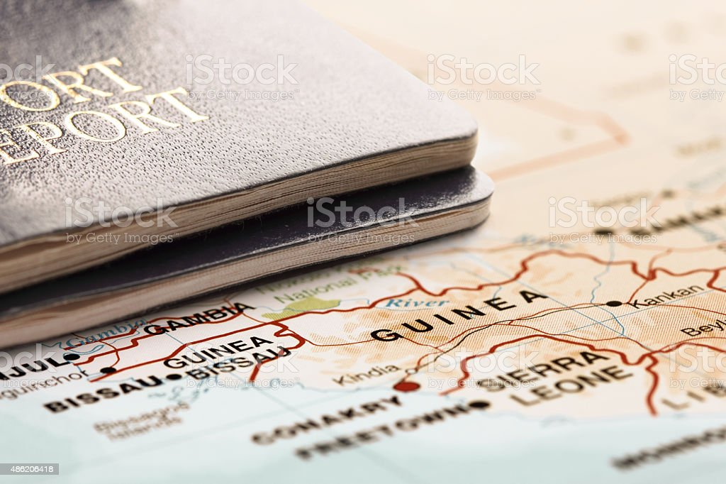 Destination Guinea. Two passports on the map. Travel concept. stock photo