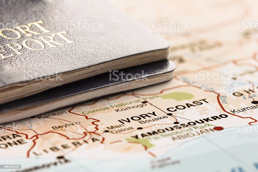 Destination Ivory Coast. Two passports on the map. Travel concept. stock photo